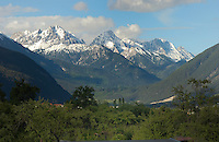 Snow capped mountains and evergreen forest. Imst district,Tyrol/Tirol. Austria.