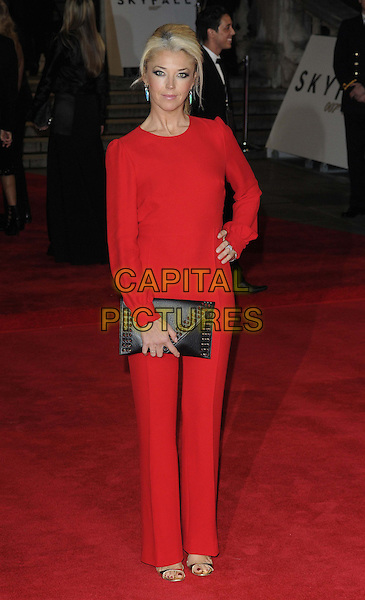 Tamara Beckwith.'Skyfall' Royal World Film Premiere, Royal Albert Hall, Kensington Gore, London, England..23rd October 2012.full length red jumpsuit hand on hip black clutch bag.CAP/CAN.©Can Nguyen/Capital Pictures.