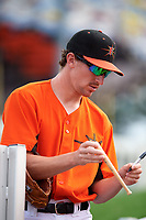 Frederick Keys pitcher Zack Muckenhirn (52) signing autographs for fans before the first game of a doubleheader against the Lynchburg Hillcats on June 13, 2018 at Nymeo Field at Harry Grove Stadium in Frederick, Maryland.  Frederick defeated Lynchburg 3-0.  (Mike Janes/Four Seam Images)