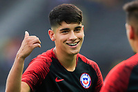 PEREIRA, COLOMBIA - JANUARY 18: Chile's Angelo Araos smiles as his team warm up before their soccer game against Ecuador during their CONMEBOL Pre-Olympic soccer game at the Hernan Ramirez Villegas Stadium on January 18, 2020 in Pereira, Colombia. (Photo by Daniel Munoz/VIEW press/Getty Images)