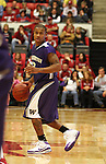 Isaiah Thomas (#2), University of Washington freshman guard, runs the offense during the Huskies game against Washington State at Friel Court in Pullman, Washington, on January 3, 2009.  The Huskies prevailed in the game 68-48 to break a seven game losing streak to the Cougars.
