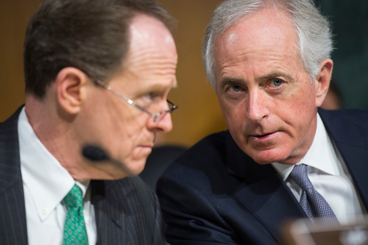 "UNITED STATES - FEBRUARY 14: Sens. Bob Corker, R-Tenn., right, and Pat Toomey, R-Pa., talk during a Senate Banking, Housing, and Urban Affairs Committee hearing in Dirksen Building titled ""The Semiannual Monetary Policy Report to the Congress,"" featuring testimony by Fed Chairwoman Janet Yellen, February 14, 2017. (Photo By Tom Williams/CQ Roll Call)"