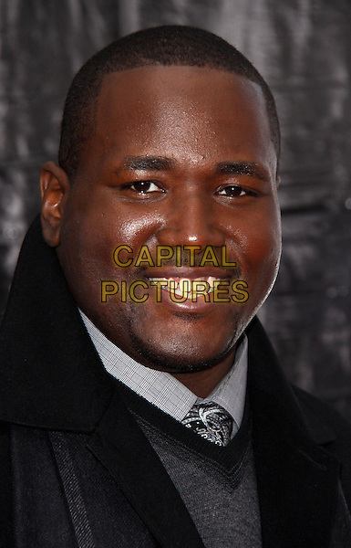 """QUINTON AARON .At the New York City Premiere of """"The Blind Side"""" held at the Ziegfeld Theater, New York, NY, USA, .17th November 2009..portrait headshot smiling goatee facial hair grey gray tie teeth .CAP/ADM/PZ.©Paul Zimmerman/AdMedia/Capital Pictures."""