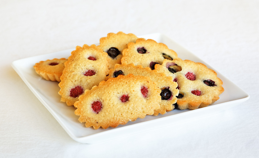 Raspberry and blueberry financier on white plate, by pastry chef Laurie Pfalzer, Pastry Craft