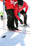 USA, Utah, Midway, Soldier Hollow, learning how to biathlon, putting on cross country skiis