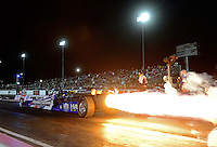 Oct. 26, 2012; Las Vegas, NV, USA: NHRA jet dragster light up the night sky during qualifying for the Big O Tires Nationals at The Strip in Las Vegas. Mandatory Credit: Mark J. Rebilas-