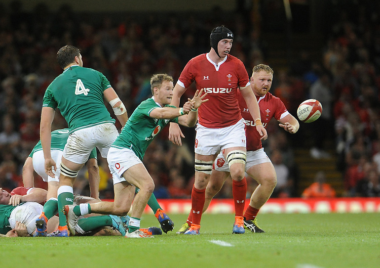 Ireland's Kieran Marmion whips the ball out <br /> <br /> Photographer Ian Cook/CameraSport<br /> <br /> 2019 Under Armour Summer Series - Wales v Ireland - Saturday 31st August 2019 - Principality Stadium - Cardifff<br /> <br /> World Copyright © 2019 CameraSport. All rights reserved. 43 Linden Ave. Countesthorpe. Leicester. England. LE8 5PG - Tel: +44 (0) 116 277 4147 - admin@camerasport.com - www.camerasport.com