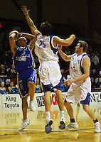 Stars forwards Adrian Majstrovich and Dillion Boucher try to stop Brendon Polybank from passing during the NBL Round 14 basketball match between the Wellington Saints and Auckland Stars at TSB Bank Arena, Wellington, New Zealand on Thursday 29 May 2008. Photo: Dave Lintott / lintottphoto.co.nz