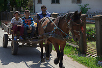 Serbia. Zitkovac is a village in Central Serbia situated in the municipality of Aleksinac, in the Nišava District. A horse drawn carriage with a Romani family (father and two sons) on their way to the Roma settlement. They carry waste construction material and will later recycle it or resell it. The Romani (also spelled Romany) or Roma, Roms or Gypsies, are a traditionally itinerant ethnic group. 19.4.2018 © 2018 Didier Ruef for the Pestalozzi Children's Foundation