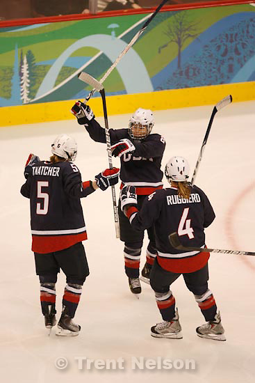 Trent Nelson  |  The Salt Lake Tribune.left to right: USA's Karen Thatcher, Caitlin Cahow and Angela Ruggiero celebrate Cahow's goal to put USA up 4-0. USA vs. Sweden, women's hockey, at the XXI Olympic Winter Games in Vancouver, Monday, February 22, 2010.