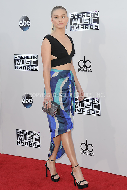 WWW.ACEPIXS.COM<br /> <br /> November 22 2015, LA<br /> <br /> Olivia Holt arriving at the 2015 American Music Awards at the Microsoft Theater on November 22, 2015 in Los Angeles, California.<br /> <br /> By Line: Peter West/ACE Pictures<br /> <br /> <br /> ACE Pictures, Inc.<br /> tel: 646 769 0430<br /> Email: info@acepixs.com<br /> www.acepixs.com