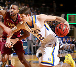BROOKINGS, SD - FEBRUARY 6:  Keaton Moffitt # 12 from South Dakota State drives against Mason Archie #2 from IUPUI during their game Saturday evening at Frost Arena in Brookings. Photo by Dave Eggen/Inertia)