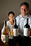 Sandra Beltran and Jerry Ward with their Ikal 1150 wines at their museum-district home Tuesday Sept. 08, 2009. (Dave Rossman/For the Chronicle)