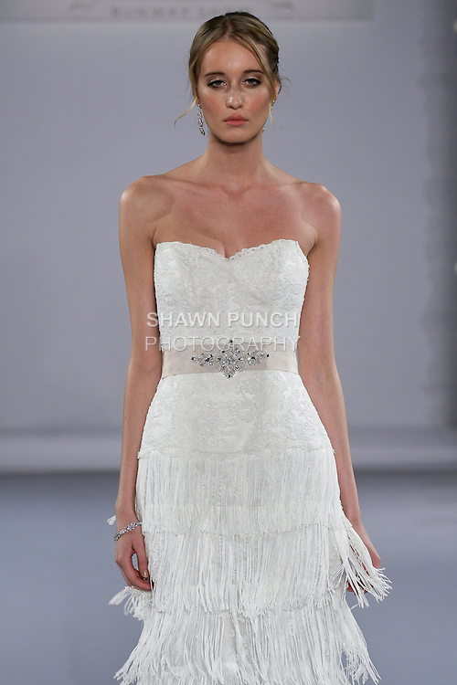 Model walks runway in a Maeleigh wedding dress from the Maggie Sottero Spring 2013 Bridal collection, for the Couture Runway Show, during New York Bridal Fashion Week at The Hilton Hotel, October 13, 2012.