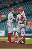 Hayden Cantrelle (5) and Kole McKinnon (11) of the Louisiana Ragin' Cajuns have a meeting at the mound against the Kentucky Wildcats in game seven of the 2018 Shriners Hospitals for Children College Classic at Minute Maid Park on March 4, 2018 in Houston, Texas.  The Wildcats defeated the Ragin' Cajuns 10-4. (Brian Westerholt/Four Seam Images)