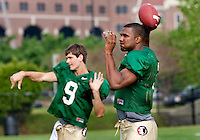 TALLAHASSEE, FLA. 3/26/11-FSU032611 CH-Florida State quarterbacks Clint Trickett, left, and EJ Manuel work during practice Saturday in Tallahassee..COLIN HACKLEY PHOTO