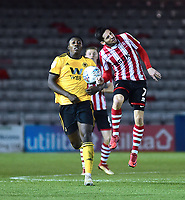 Lincoln City's Tom Pett vies for possession with Wolverhampton Wanderers U21's Benny Ashley-Seal<br /> <br /> Photographer Andrew Vaughan/CameraSport<br /> <br /> The EFL Checkatrade Trophy Northern Group H - Lincoln City v Wolverhampton Wanderers U21 - Tuesday 6th November 2018 - Sincil Bank - Lincoln<br />  <br /> World Copyright © 2018 CameraSport. All rights reserved. 43 Linden Ave. Countesthorpe. Leicester. England. LE8 5PG - Tel: +44 (0) 116 277 4147 - admin@camerasport.com - www.camerasport.com