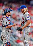 1 August 2018: New York Mets starting pitcher Noah Syndergaard gets a visit to the mound from catcher Devin Mesoraco during a game against the Washington Nationals at Nationals Park in Washington, DC. The Nationals defeated the Mets 5-3 to sweep the 2-game weekday series. Mandatory Credit: Ed Wolfstein Photo *** RAW (NEF) Image File Available ***