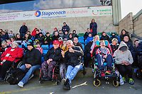 Lincoln City fans watch their team in action<br /> <br /> Photographer Chris Vaughan/CameraSport<br /> <br /> The EFL Sky Bet League Two - Lincoln City v Cheltenham Town - Saturday 13th April 2019 - Sincil Bank - Lincoln<br /> <br /> World Copyright &copy; 2019 CameraSport. All rights reserved. 43 Linden Ave. Countesthorpe. Leicester. England. LE8 5PG - Tel: +44 (0) 116 277 4147 - admin@camerasport.com - www.camerasport.com