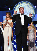 United States President Donald Trump dances with First Lady Melanie Trump while attending the Freedom Ball on January 20, 2017 in Washington, D.C.  Trump will attend three inaugural balls.    <br /> Credit: Kevin Dietsch / Pool via CNP