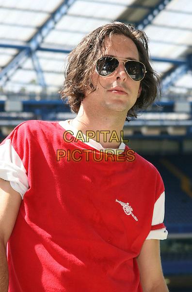 CARL BARAT .Celebrity Soccer Six in aid of The Samaritans held at Chelsea Football ground, Stamford Bridge, London, England, UK, May 24th 2009.football match game half length red top t-shirt ray bans sunglasses aviators .CAP/JIL.©Jill Mayhew/Capital Pictures