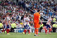 Raul Garcia, Arda Turan, Griezman, Godin, Manzukiz and Koke of Atletico de Madrid during La Liga match between Real Madrid and Atletico de Madrid at Santiago Bernabeu stadium in Madrid, Spain. September 13, 2014. (ALTERPHOTOS/Caro Marin)