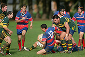 M. Lawson goes to ground with the help of S. Tualaulelei. Counties Manukau Premier Club Rugby, Pukekohe v Ardmore Marist played at the Colin Lawrie field, on the 27th of May 2006.Ardmore Marist won 22 - 6