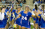 Costa Mesa, CA 02/20/16 - Casey Black (Duke #15) and Charlotte Tucci (Duke #24) take the field for their game against USC.