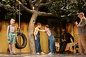 """25/06/2015. London, UK. Ava Potter as Scout with Tommy Rodger as Jem and Connor Brundish as Dill. Photocall for """"To Kill a Mockingbird"""" at the Barbican Theatre with Robert Shean Leonard as Atticus Finch and Ava Potter as Scout.  The Regent's Park Open Air Theatre production directed by Timothy Sheader will be at the Barbican from 24 June to 25 July 2015. Adapted for the stage by Christopher Sergel based on the novel by Harper Lee."""