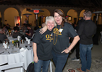 Wendy Gobar and Jennifer Townsend Crosthwaite '84 P'20<br /> Now in his 30th year as Oxy's head men's basketball coach, Brian Newhall received a much deserved celebration with a surprise halftime ceremony and post game reception in the Booth Hall courtyard with more than 70 former and current players from all different generations and decades in attendance, on Saturday, Jan. 26, 2019.<br /> Newhall is the winningest coach in Oxy history and has a 100 percent graduation rate in his 30 years at the helm of the program. His resume boasts multiple SCIAC Championships and NCAA Playoff appearances, along with a run to the NCAA Division III Elite Eight in 2003 and the only perfect 14-0 season in SCIAC history. Newhall has not only coached at Oxy, but was a SCIAC Champion and SCIAC Player of the Year during his playing career at Oxy in the early 80s.<br /> (Photo by Marc Campos, Occidental College Photographer)