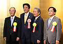 January 5, 2017, Tokyo, Japan - Japanese Prime Minister Shinzo Abe (2nd L) posess with Japanese business group leaders Akio Mimura (L), Sadayuki Sakakibara (2nd R) and Yoshimitsu Kobayashi (R) for photo prior to a business leaders' New Year party at a Tokyo hotel on Tuesday, January 5, 2017.  (Photo by Yoshio Tsunoda/AFLO)