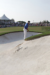 Louis Oosthuizen trying to play his chip onto the 18th during the final round of the Dubai World Championship on the Earth Course at the Jumeirah Golf Estate, Dubai..Picture Fran Caffrey/www.golffile.ie.