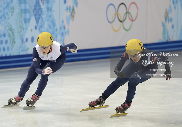 Ellise Christie (GBR) has to come around the outside to progress through to the semil finals. Womens 1000m quarter finals - Short track skating - Iceberg skating Palace - Olympic Park - PHOTO: Mandatory by-line: Garry Bowden/SIPPA/Pinnacle - Photo Agency UK Tel: +44(0)1363 881025 - Mobile:0797 1270 681 - VAT Reg No: 768 6958 48 - 210214 - 2014 SOCHI WINTER OLYMPICS - Olympic park, Sochii, Russia