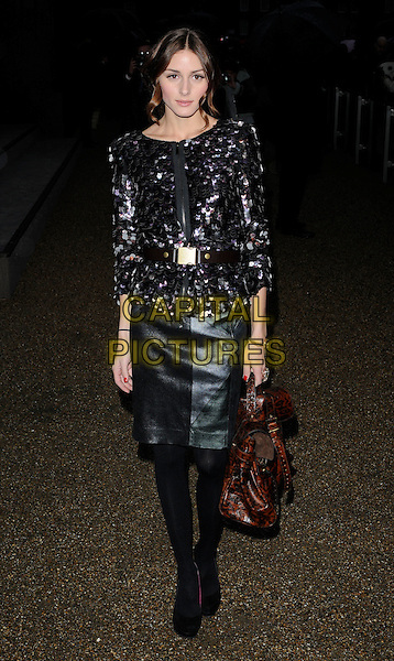 OLIVIA PALERMO.Arriving at the Burberry Prorsum Fashion show, London Fashion Week, Day 5, Chelsea College Of Art And Design, London, England .February 23rd, 2010 .LFW full length zip belt waist skirt Mulberry bag purple sequined sequin paillettes top leather discs brown animal print leopard ankle boots black .CAP/CAN.©Can Nguyen/Capital Pictures.