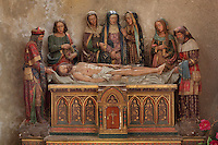 Polychrome sculptural group of the entombment, with the body of Christ and a grieving Virgin, in Saint Volusian Abbey, or the Abbatiale Saint-Volusien, in Foix, Ariege, Midi-Pyrenees, France. The original abbey church was built in the 12th century, but was later destroyed and rebuilt in the 17th century. The abbey houses the relics of St Volusian, 7th bishop of Tours, who died c. 495 AD, and its buildings now house the Prefecture of the Ariege. Picture by Manuel Cohen