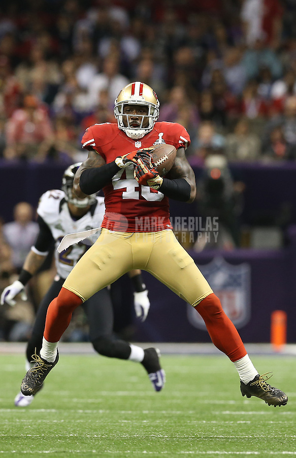 Feb 3, 2013; New Orleans, LA, USA; San Francisco 49ers tight end Delanie Walker (46) catches a pass against the Baltimore Ravens in Super Bowl XLVII at the Mercedes-Benz Superdome. Mandatory Credit: Mark J. Rebilas-