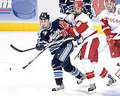 John Hopson, Josh Engel - The University of Wisconsin Badgers defeated the University of Maine Black Bears 5-2 in their 2006 Frozen Four Semi-Final meeting on Thursday, April 6, 2006, at the Bradley Center in Milwaukee, Wisconsin.  Wisconsin would go on to win the Title on April 8, 2006.