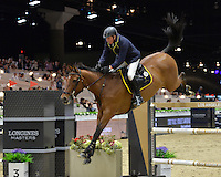 John Whitaker (Great Britain), riding Lord of Arabia at the Gucci Gold Cup International Jumping competition at the 2015 Longines Masters Los Angeles at the L.A. Convention Centre.<br /> October 3, 2015  Los Angeles, CA<br /> Picture: Paul Smith / Featureflash