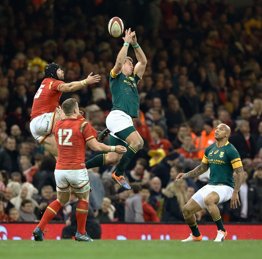 South Africa's Ruan Combrinck and South Africa's Johan Goosen go for the high ball<br /> <br /> Photographer Simon King/CameraSport<br /> <br /> International Rugby Union Friendly - Wales v South Africa - Saturday 26th November 2016 - Principality Stadium - Cardiff<br /> <br /> World Copyright &copy; 2016 CameraSport. All rights reserved. 43 Linden Ave. Countesthorpe. Leicester. England. LE8 5PG - Tel: +44 (0) 116 277 4147 - admin@camerasport.com - www.camerasport.com