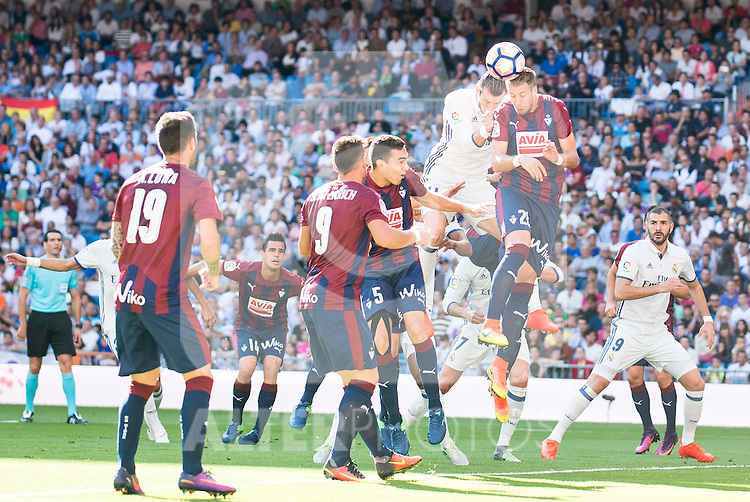 Real Madrid's players Gareth Bale and Karim Benzema and Eibar FC's players Antonio Luna, Sergi Enrich, Gonzalo Escalante and Pedro Leon Sanchez during a match of La Liga Santander at Santiago Bernabeu Stadium in Madrid. October 02, Spain. 2016. (ALTERPHOTOS/BorjaB.Hojas)