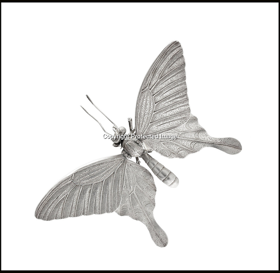 BNPS.co.uk (01202 558833)<br /> Pic: Bonhams/BNPS<br /> <br /> ****Please use full byline****<br /> <br /> A butterfly.<br /> <br /> A hand-made set of incredibly detailed silver insects has emerged and is expected to fetch £80,000 at auction.<br /> <br /> The beautiful collection features 12 life-life creatures including a dragonfly, praying mantis, stag beetle, hornet, locust, cricket, grasshopper and butterfly.<br /> <br /> They were created by Takase Torakichi, also known as Takase Kozan, who was a well known artist in Japan in the late 19th century.