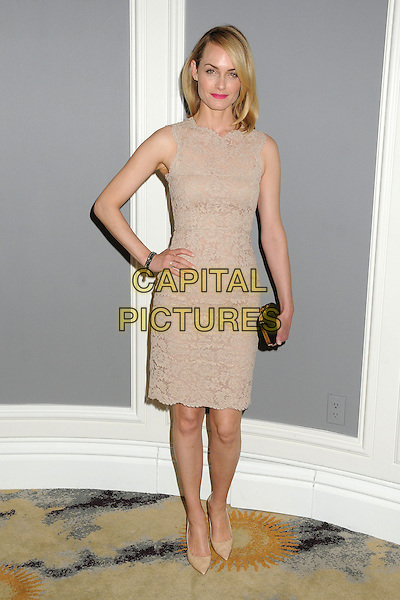 Amber Valletta.Big Brothers Big Sisters of Greater Los Angeles 2013 Accessories for Success Spring Luncheon held at The Beverly Hills Hotel, Beverly Hills, California, USA, .12th April 2013..full length lace nude dress hand on hip sleeveless beige black clutch bag .CAP/ADM/BP.©Byron Purvis/AdMedia/Capital Pictures