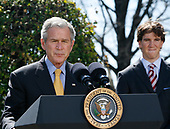 United States President George W. Bush makes a Statement on The National President's Challenge in the East Garden of the White House, Washington DC on March 20, 2008.  Pictured at right is New York Giants quarterback Eli Manning.<br /> Credit: Aude Guerrucci / Pool via CNP