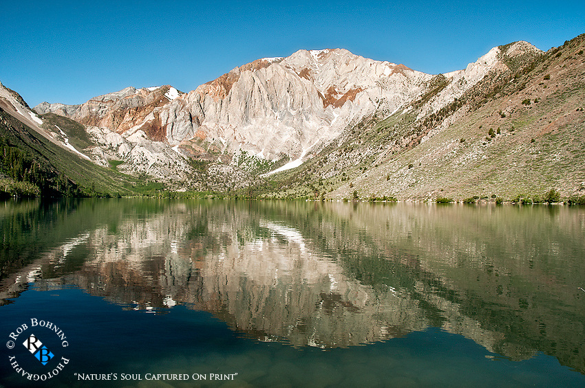 Last snow melt on Convict Lake as it reflects its mirror image
