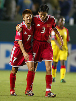 Bai Jie, left, Liu Ying, right, celebrate a goal,  2003 WWC China vs. Ghana