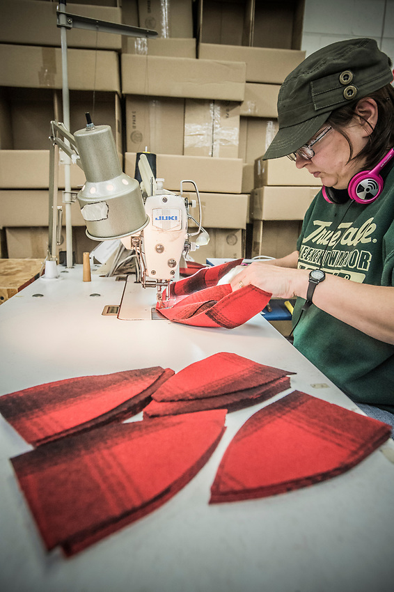 Second step in the Stormy Kromer manufacturing process sewing the hat panels together at the Ironwood, Michigan production facility.