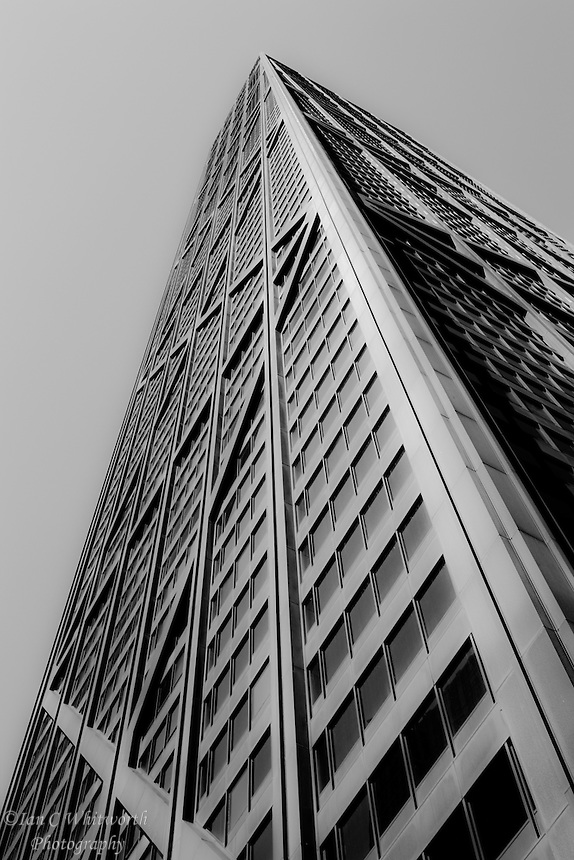 Looking up at the John Hancock Building in black and white in Chicago