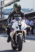 Glen Allerton (AUS) riding the BMW S1000RR of the Next Gen Motorsports team leaving the pits for a practise session on day one of round one of the 2013 FIM World Superbike Championship at Phillip Island, Australia.