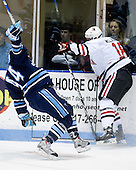 Ryan Hegarty (Maine - 44), Mike McLaughlin (NU - 18) - The University of Maine Black Bears defeated the Northeastern University Huskies 6-2 on Friday, November 13, 2009, at Matthews Arena in Boston, Massachusetts.