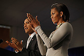 United States President Barack Obama (L) and first lady Michelle Obama applaud before the president signs the Healthy, Hunger-Free Kids Act of 2010 at Harriet Tubman Elementary School, Monday, December 13, 2010 in Washington, DC. In an effort to provide children with better school lunches and breakfasts, the new law puts $4.5 million in the hands of child nutrition programs, sets nutrition standards on school vending machines, helps create school gardens and makes sure that quality drinking water is available during meal times. .Credit: Chip Somodevilla - Pool via CNP